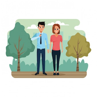 Jeune couple dans le paysage du parc