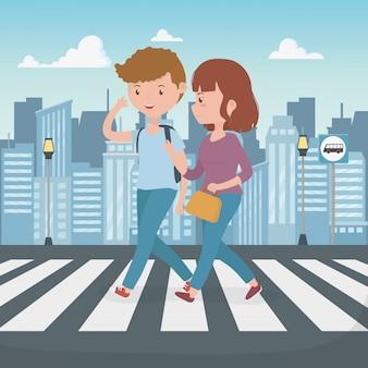 Jeune couple marchant dans la rue personnages