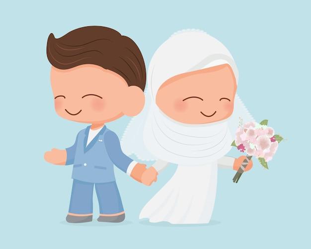 Jeune couple de mariage musulman en robe de mariée costume bleu