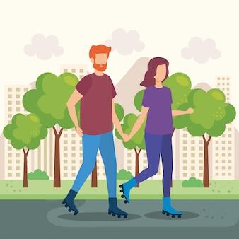 Jeune couple avec des patins dans le parc