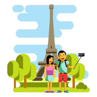 Jeune couple prenant selfie près de la tour eiffel