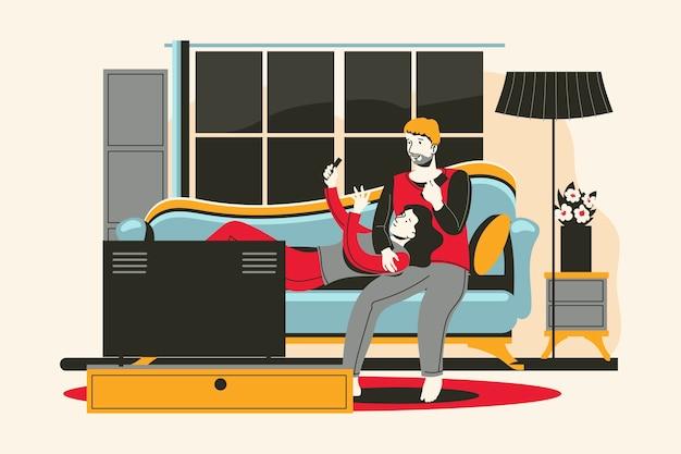 Un jeune couple se détendre avec un gadgets dans le salon
