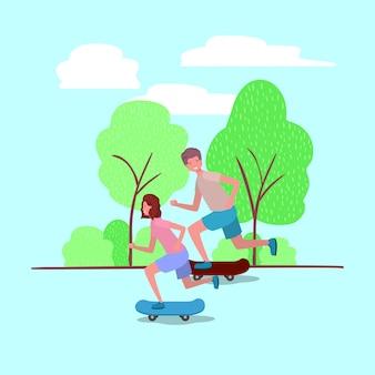 Jeune couple en skateboard sur le parc