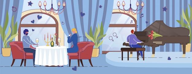 Jeune couple en train de dîner romantique dans un restaurant de luxe.