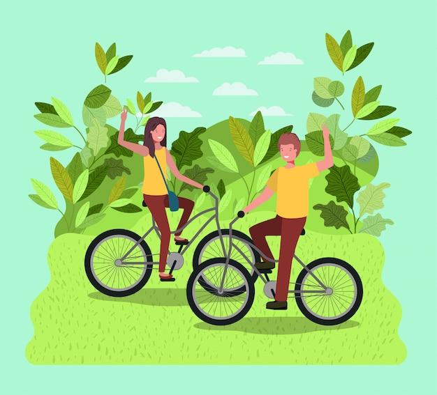 Jeune couple à vélo dans le parc