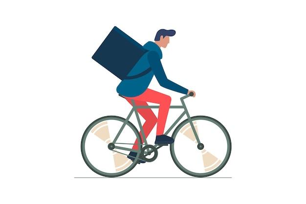 Un jeune courrier masculin avec un sac à dos à vélo transporte un service de commande de livraison écologique à vélo rapide