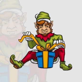 Jeune elfe mâle décorant une boîte-cadeau de noël avec un ruban