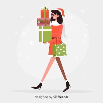 Jeune femme achète des cadeaux de noël