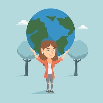 Jeune femme d'affaires caucasien tenant le globe.