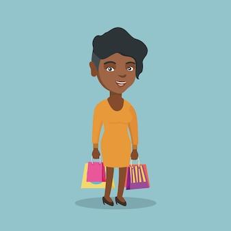 Jeune femme afro-américaine avec des sacs à provisions.