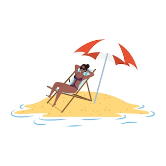 Jeune femme afro se détendre sur la plage assis dans une chaise et un parasol