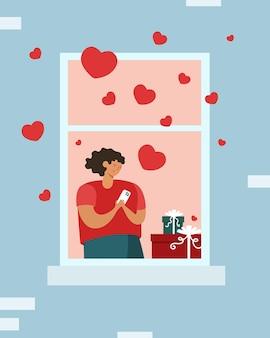Jeune femme avec l'amour virtuel en ligne de téléphone dans la fenêtre