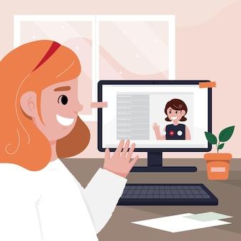 Une jeune femme bavarde sur son ordinateur portable pour éviter les infections.