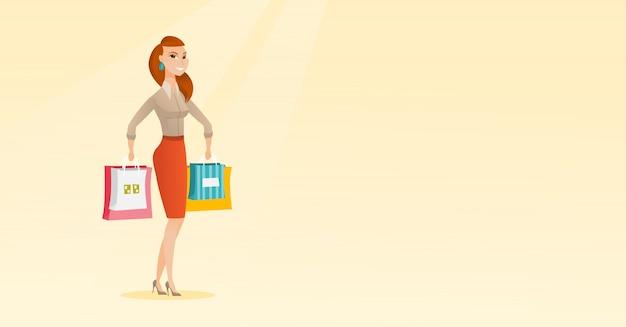 Jeune femme caucasienne heureuse avec des sacs à provisions.