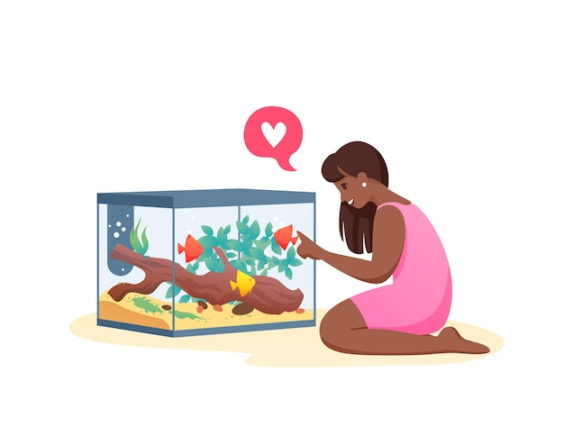 Jeune femme communique avec les poissons. la fille aime les poissons, prenez soin de l'aquarium.