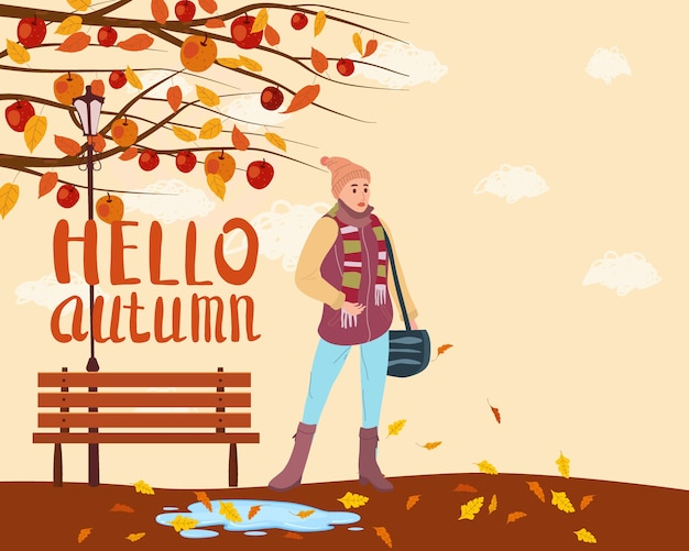 Jeune femme dans la ville de parc automne, vêtements à la mode rue vêtements à la mode de style femme, humeur d'automne. lettrage bonjour l'automne