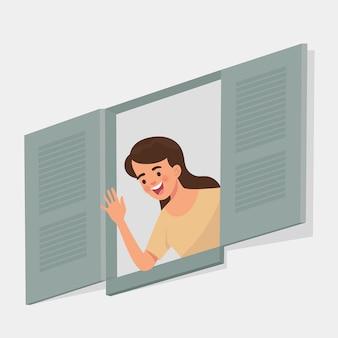 Jeune femme dit bonjour d'une fenêtre ouverte