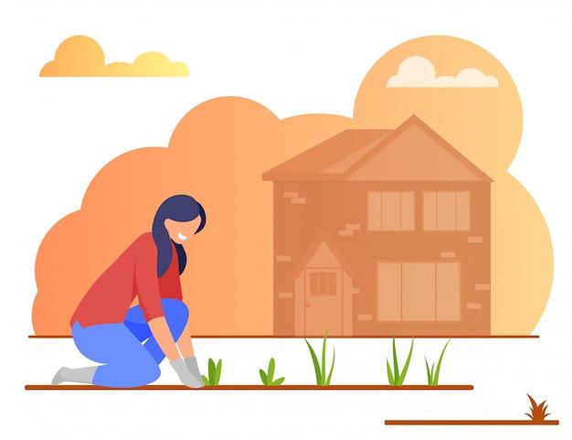 Jeune femme, fermier, dans, gants, planter des fleurs