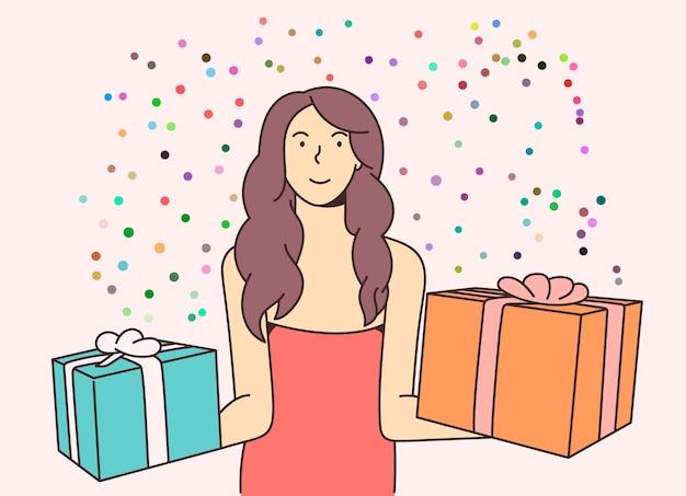 Jeune femme heureuse joyeuse souriante excitée célébrant le nouvel an et tenant des cadeaux