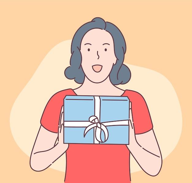 Jeune femme jolie brune heureuse sortie boîte-cadeau
