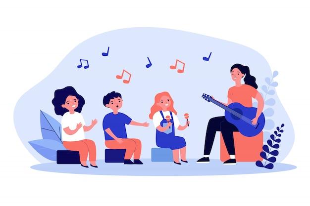 Jeune, femme, jouer, guitare, enfants