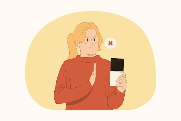 Jeune femme mécontente montrant le geste d'arrêt avec la paume au concept de barre de chocolat