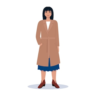 Jeune femme à la mode dans un manteau et des bottes. vêtements de style urbain d'automne.