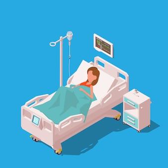 Jeune femme patiente dans un lit d'hôpital avec des équipements médicaux.