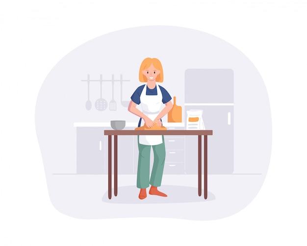 Jeune femme pétrir la pâte sur la table dans la cuisine. jolie jeune fille prépare des repas à la maison. spectacle de passe-temps culinaire de dessin animé plat