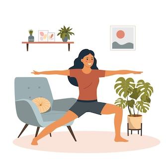 Jeune femme de remise en forme dans la pose de yoga dans le salon.