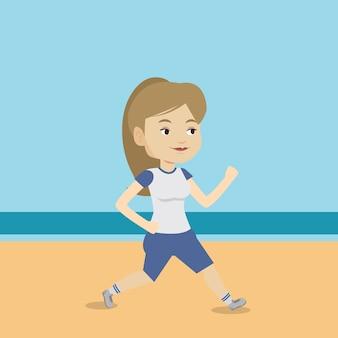 Jeune femme sportive jogging sur la plage.