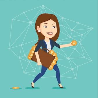 Jeune femme tenant une mallette avec des pièces bitcoin.