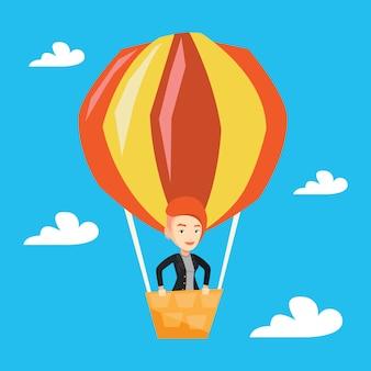 Jeune femme volant en montgolfière.