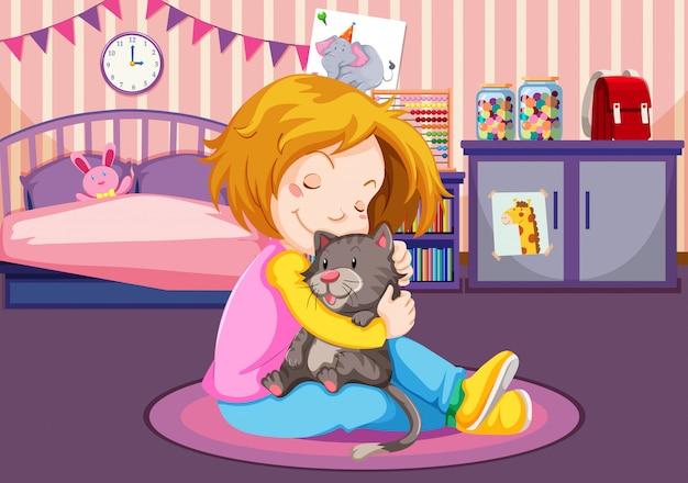 Jeune fille câlinant un chaton