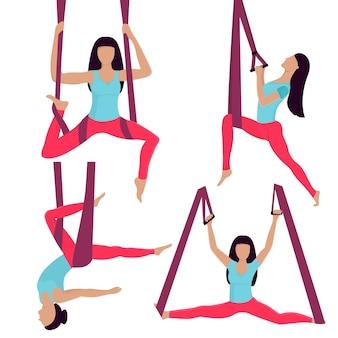 Une jeune fille effectue des exercices de yoga dans un hamac.
