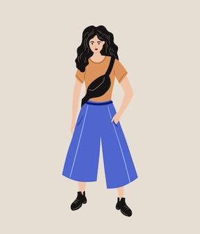 Jeune fille élégante vêtue d'un t-shirt et d'une jupe-culotte style street wear