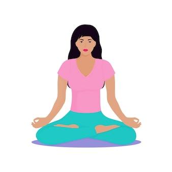 Une jeune fille est assise en position du lotus. la femme fait du yoga. chin mudra.