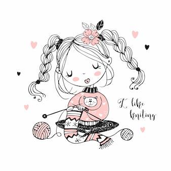 La jeune fille est engagée dans la couture en tricotant une écharpe.