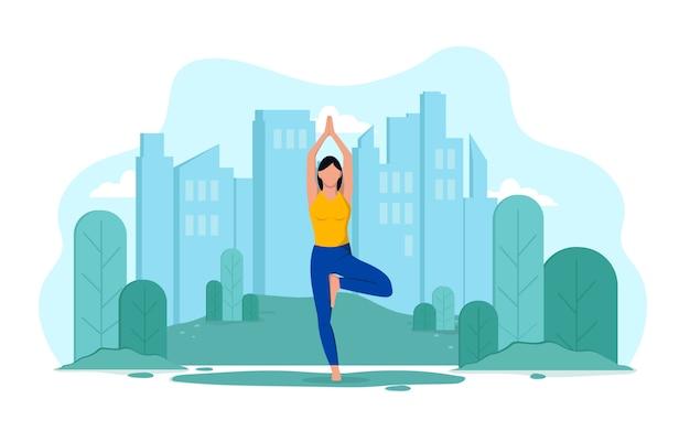 Jeune fille mince flexible fait du yoga en plein air dans le parc. la fille sur le fond de la ville et des arbres fait des exercices, se détend.