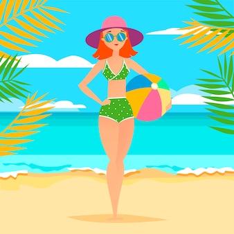 Jeune fille sportive avec ballon sur la plage