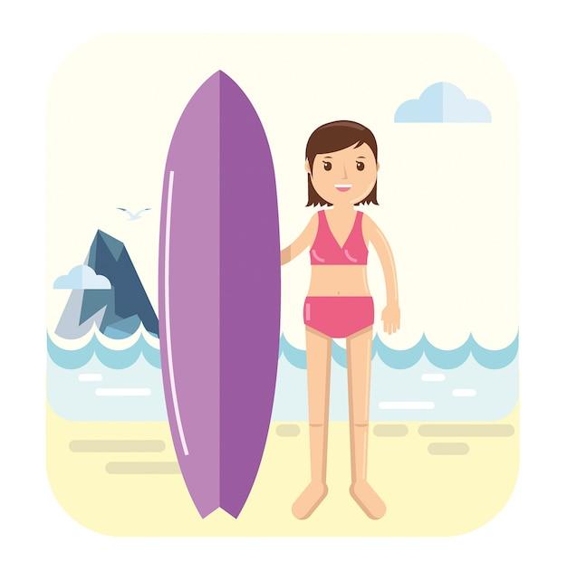 Jeune fille surfeur pose à côté de sa planche de surf