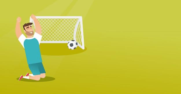 Jeune footballeur caucasien célébrant un but