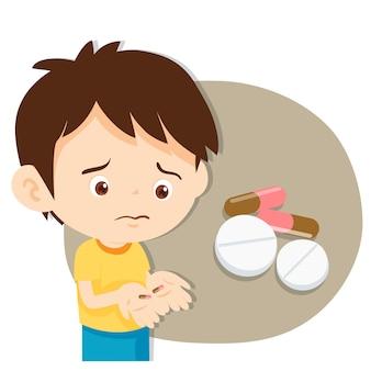Jeune garçon avec des médicaments