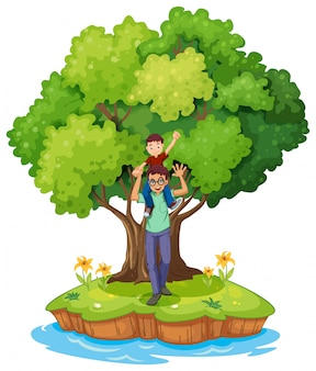 Un jeune garçon porté par son père près du grand arbre
