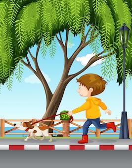 Jeune garçon promener son chien