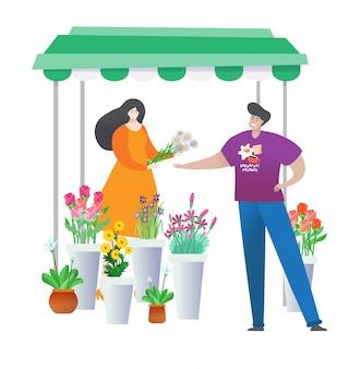 Jeune homme acheter ou choisir le meilleur bouquet de fleurs différentes pour votre fille en magasin isolé sur blanc.