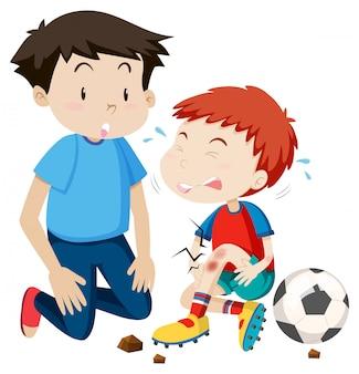 Jeune homme aide à blesser le joueur de football