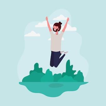 Jeune homme à la barbe sautant dans le personnage du parc