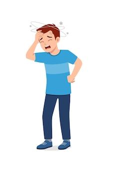 Un jeune homme beau ressent des maux de tête et de la douleur