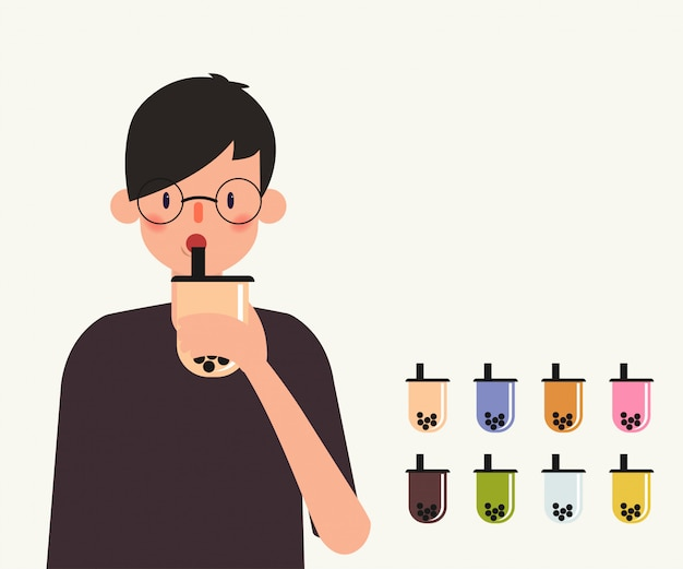 Jeune homme boire du thé au lait à bulles.